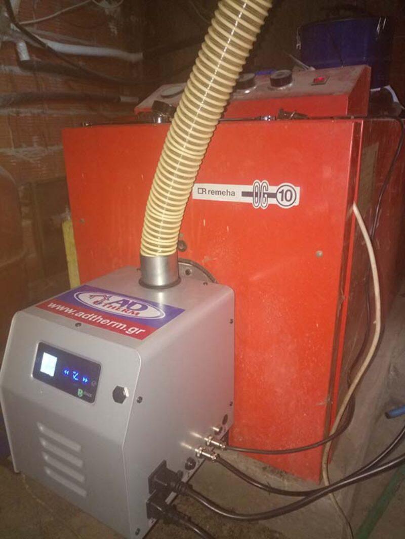 Καυστήρας βιομάζας σε μαντεμένιο λέβητα πετρελαίου REMEHA στην Στρατονίκι